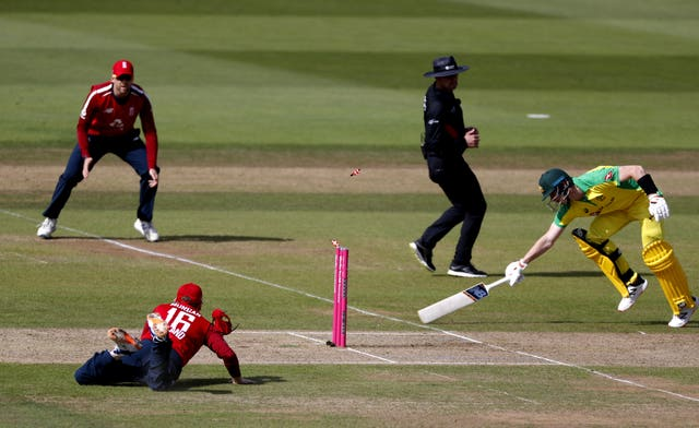 Eoin Morgan, bottom left, ran out Australia's Steve Smith with a brilliant piece of fielding but later dislocated his finger in the field