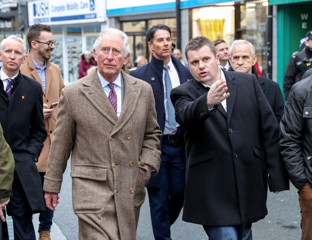The Prince of Wales meets residents and businesses affected by recent floods in Pontypridd