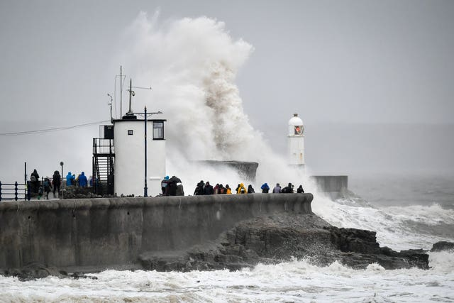Waves pound against the harbour wall at Porthcawl, Wales