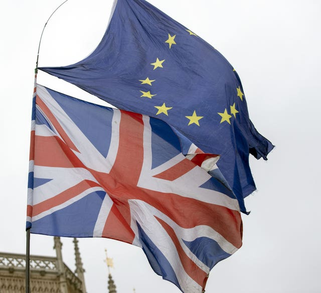 Union and EU flags flying outside the Palace of Westminster (Steve Parsons/PA)