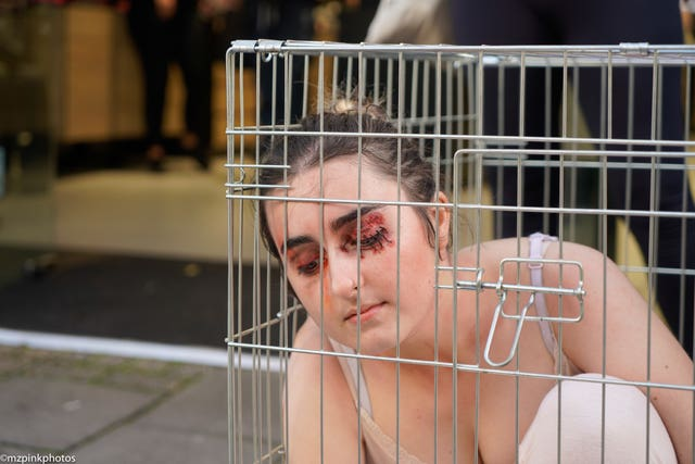 An activist takes part in a Mac Cosmetics protest in Brighton
