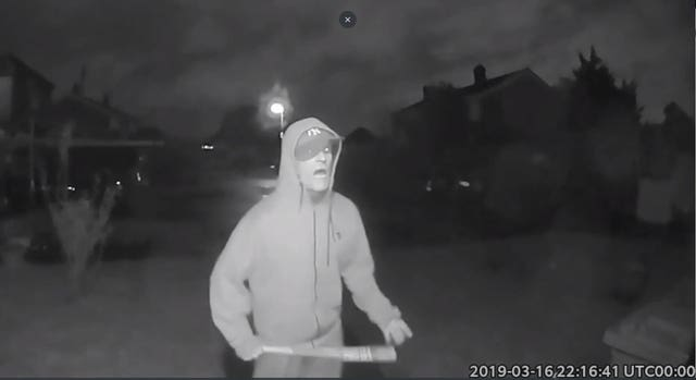 CCTV showing Vincent Fuller swinging a baseball bat outside a neighbour's house in Stanwell
