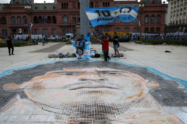 A mosaic of the face of Diego Maradona is painted on Plaza de Mayo, in front of the presidential palace in Buenos Aires