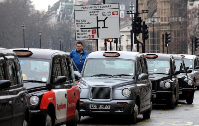 Taxi drivers line the street in Whitehall, London