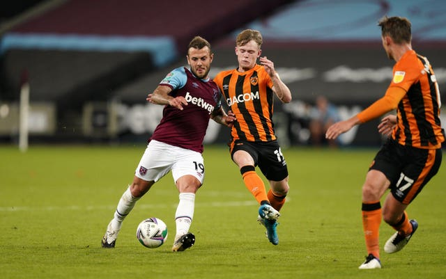 Jack Wilshere, left, in action against Hull in his final appearance for West Ham