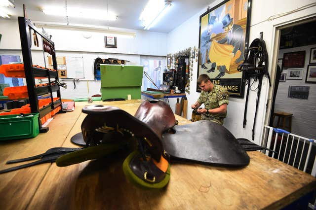 A member of the Household Cavalry hard at work getting things ready in the Saddlers Shop (Kirsty O'Connor/PA)
