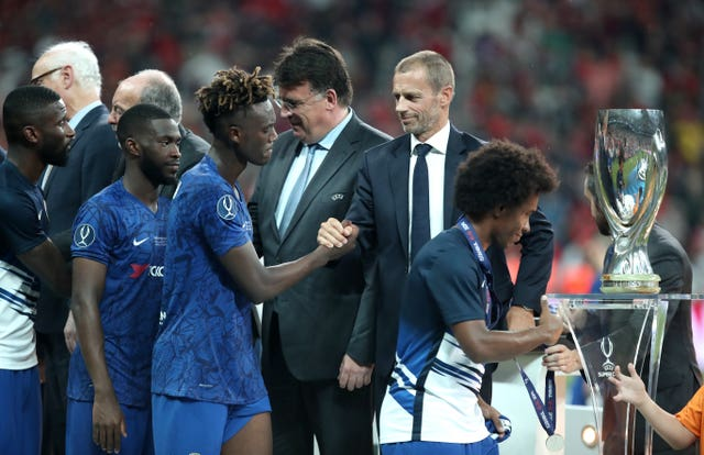 Tammy Abraham shakes hands with UEFA chairman Aleksander Ceferin