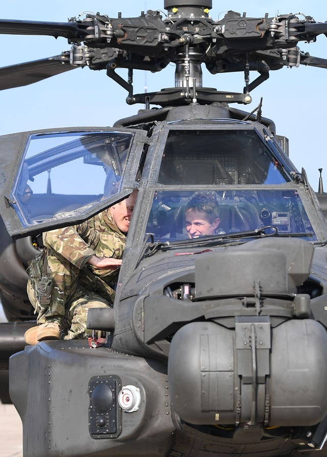 Defence Secretary Gavin Williamson in the cockpit of an Apache helicopter at Wattisham Airfield in Suffolk