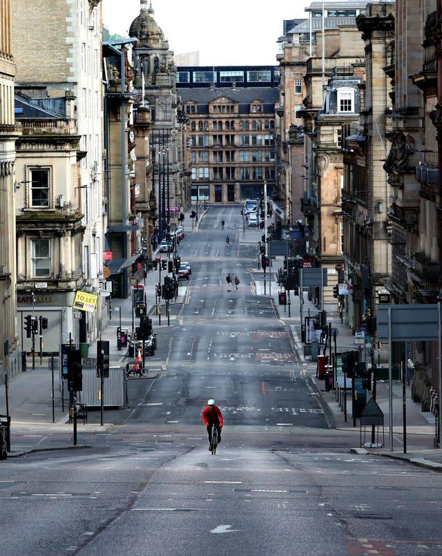 Cyclist on quiet Glasgow street
