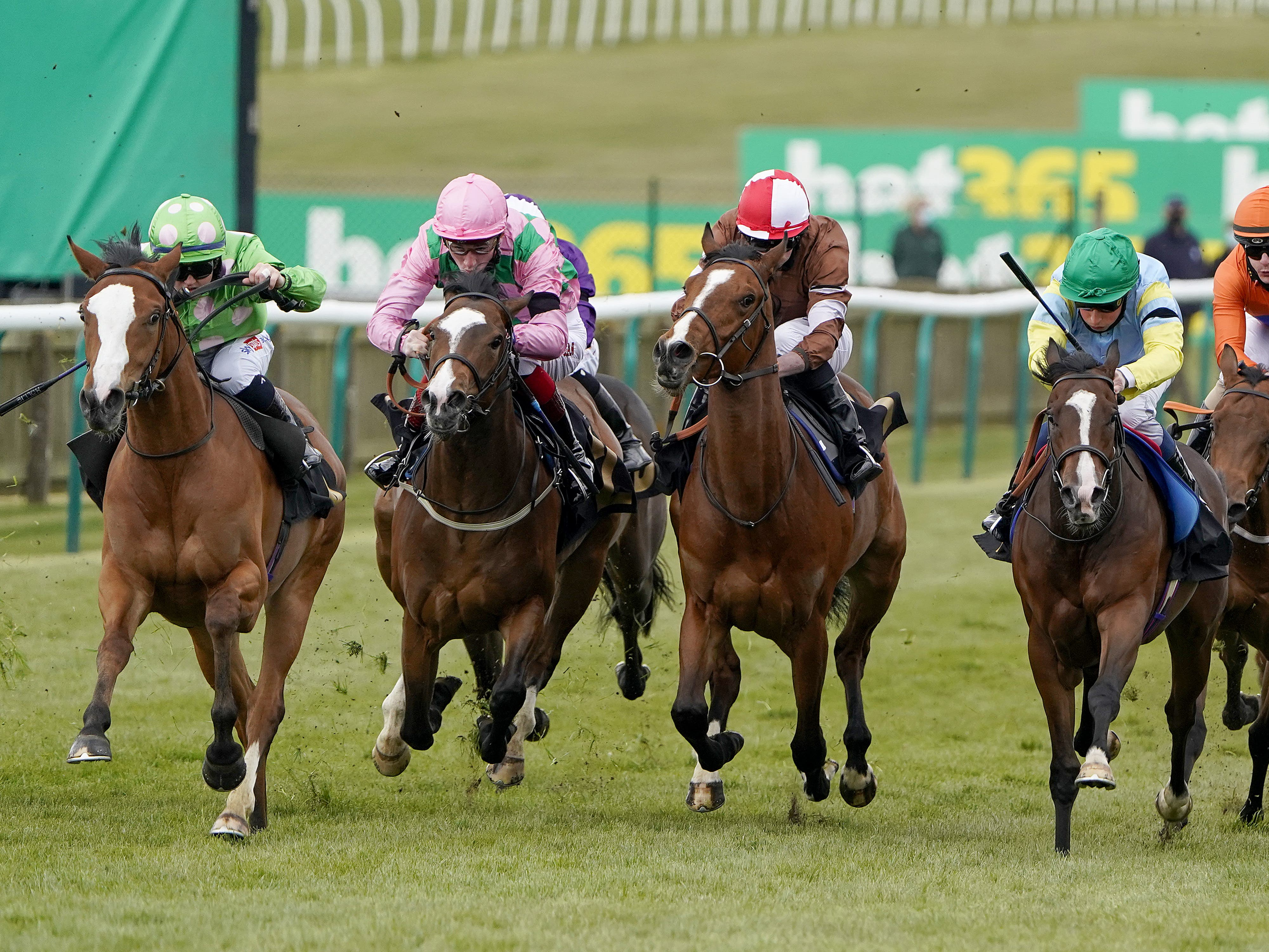 Hollie Doyle riding Desert Dreamer (left) on their way to winning The bet365 British EBF Maiden Fillies' Stakes at Newmarket Racecourse (Alan Crowhurst/PA)