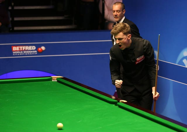 Cahill celebrates after beating O'Sullivan 10-8