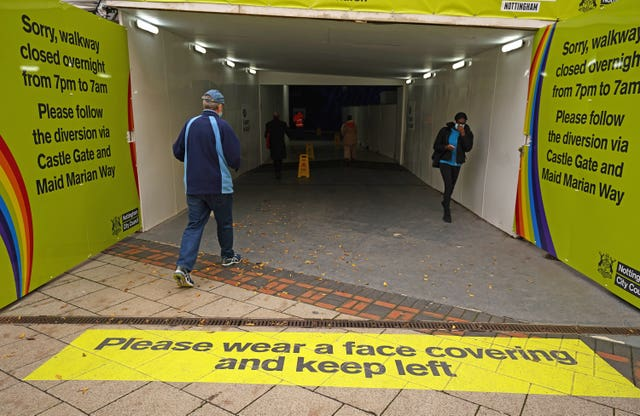People enter an underpass in Nottingham (Tim Goode/PA)