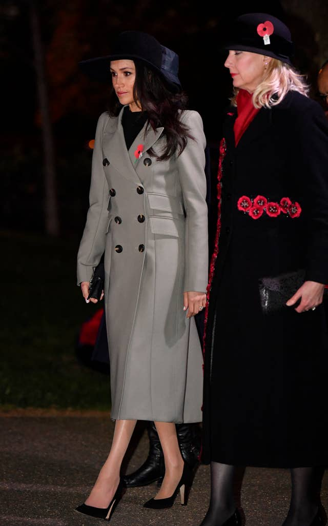 Ms Markle's black suede shoes were the Sarah Flint Jay Pump (Toby Melville/PA)