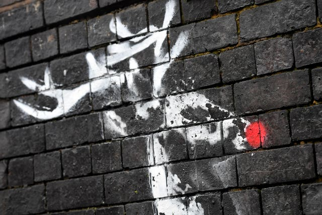 A new Banksy artwork in Birmingham's Jewellery Quarter appears to have been vandalised