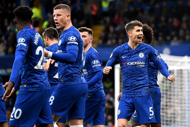 Chelsea's Jorginho, right, celebrates scoring from the penalty spot