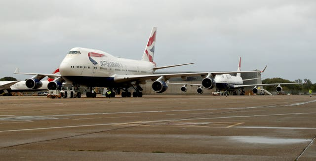 The last two British Airways Boeing 747-400 aircraft, designated G-CIVY (front) and G-CIVB prepare for the final flight from Heathrow Airport (Steve Parsons/PA)
