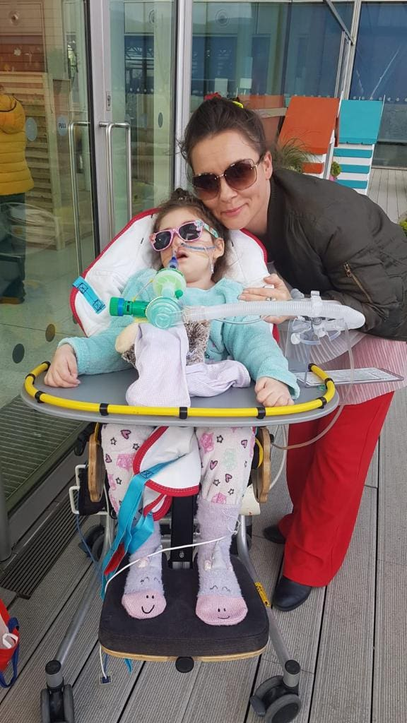 Paula Parfitt and daughter outside due to portable ventilator