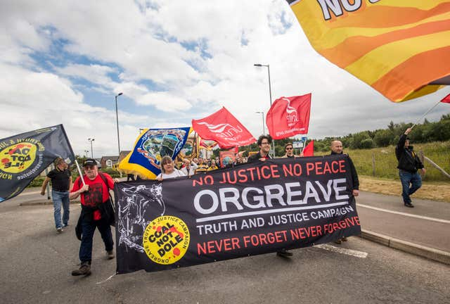 Protesters hold a banner calling for a public inquiry over the Battle of Orgreave