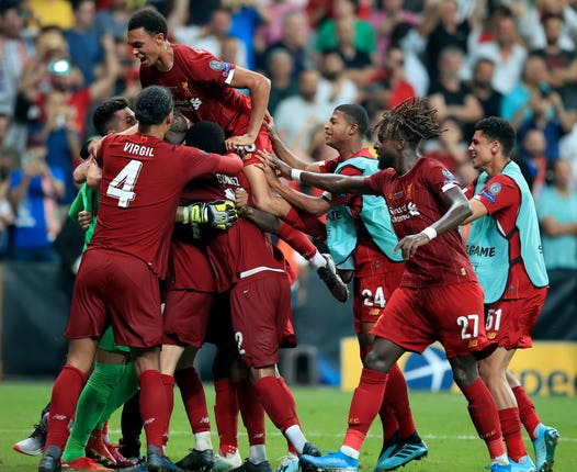 Liverpool goalkeeper Adrian is mobbed by his Liverpool team-mates on Wednesday