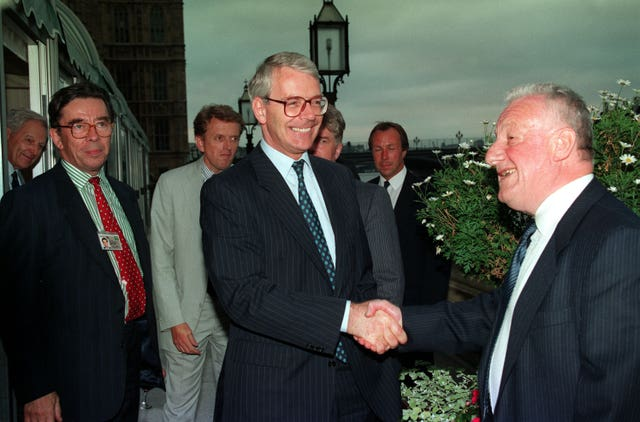 Chris Moncrieff gets a handshake from then-prime minister John Major on his resignation as PA political editor in 1994