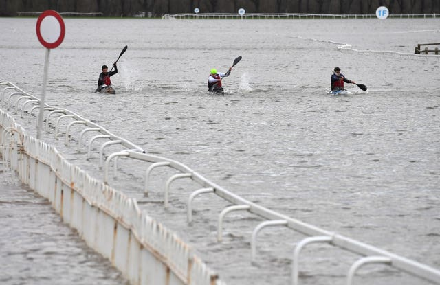 Kayakers on a flooded Worcester racecourse