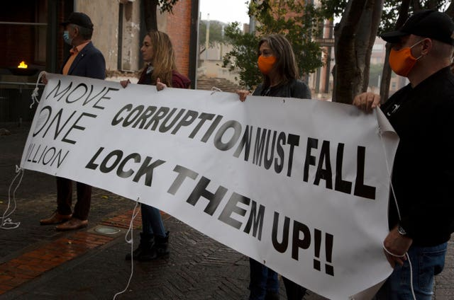 Protesters against former South African president Jacob Zuma (Denis Farrell/AP)