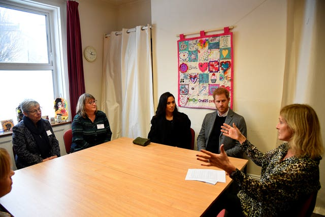 Meghan and Harry meet staff and volunteers during their visit to One25