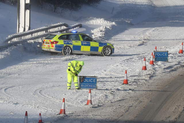 The M876 to Glasgow is closed due to snow (Andrew Milligan/PA)