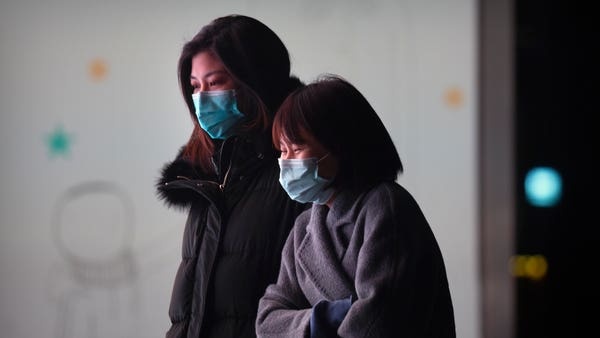 China sees new coronavirus case spike ahead of WHO research visit