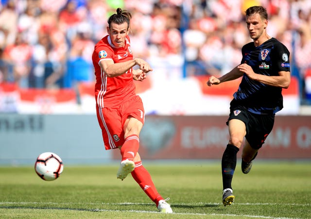 Gareth Bale (left) fires goalwards but without luck in Osijek