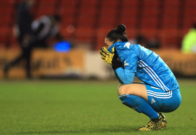 Arsenal goalkeeper Manuela Zinsberger appears dejected after the final whistle of the FA Women's Continental League Cup final