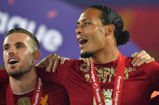 Virgil Van Dijk, right, and Jordan Henderson celebrate winning the Premier League title