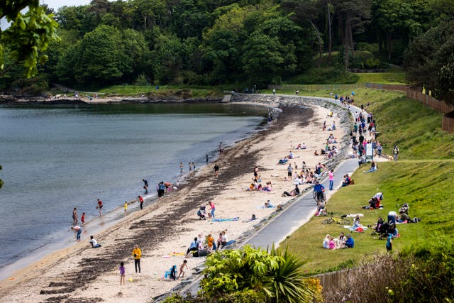 Crowds gather at the beach and along the footpath at Helen's Bay in Co Down