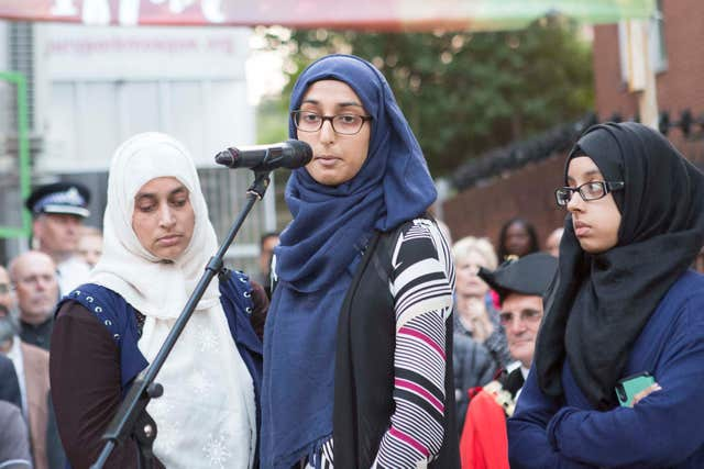 Ruzina Akhtar (centre) daughter of Makram Ali, who was killed in the attack, makes a speech