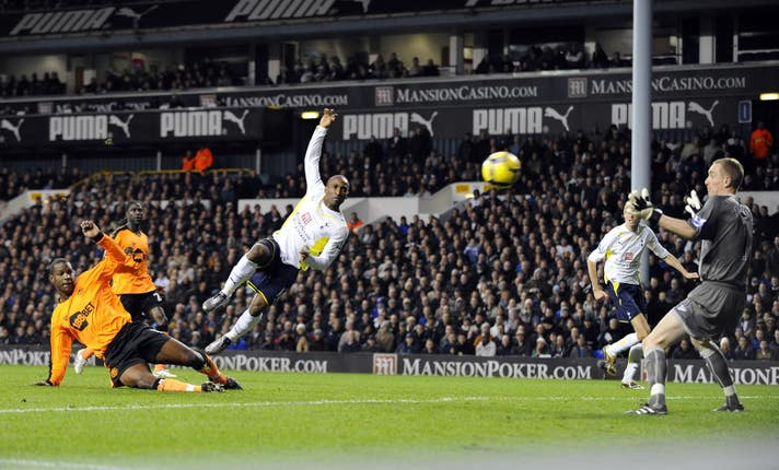 Jermain Defoe, centre, scores Tottenham's second goal against Wigan