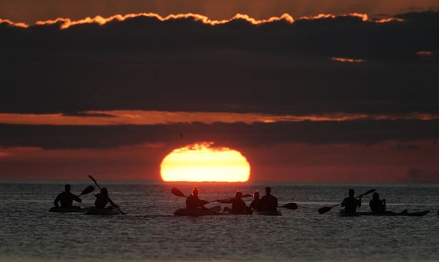 Kayakers watch dawn break in North Tyneside
