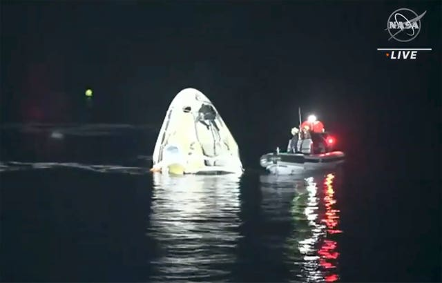 The SpaceX Dragon capsule floats after landing in the Gulf of Mexico