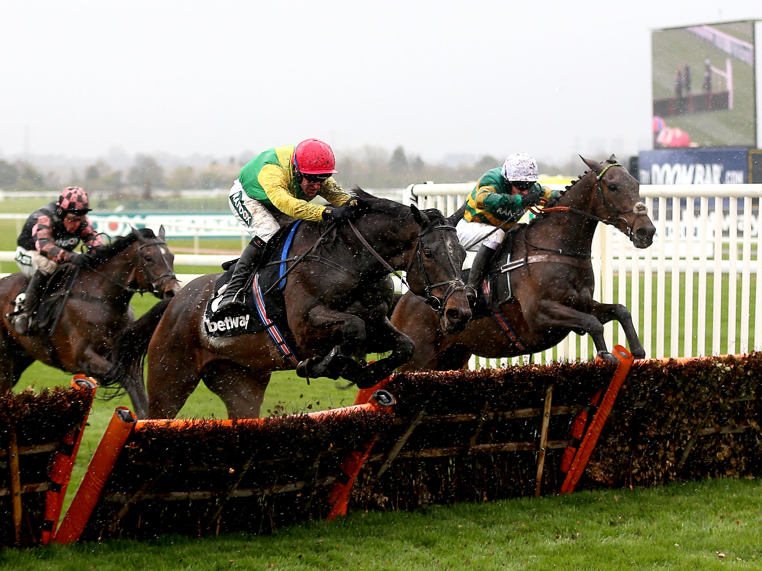 Supasundae gets the better of Buveur D'Air at Aintree (Nigel French/PA)