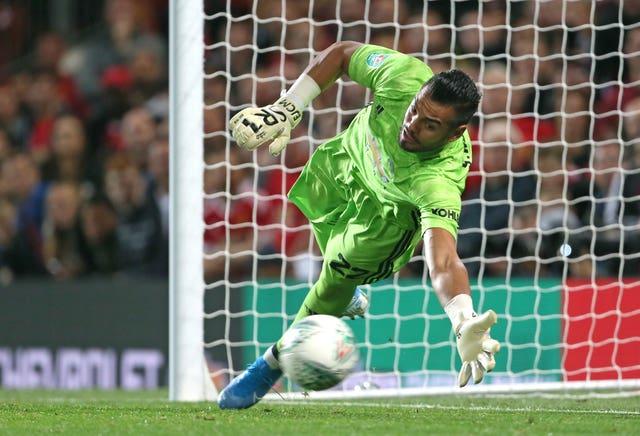 Romero's save sent United through