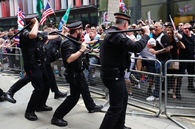 Supporters of Tommy Robinson face off with police outside the Old Bailey in London (Aaron Chown/PA)
