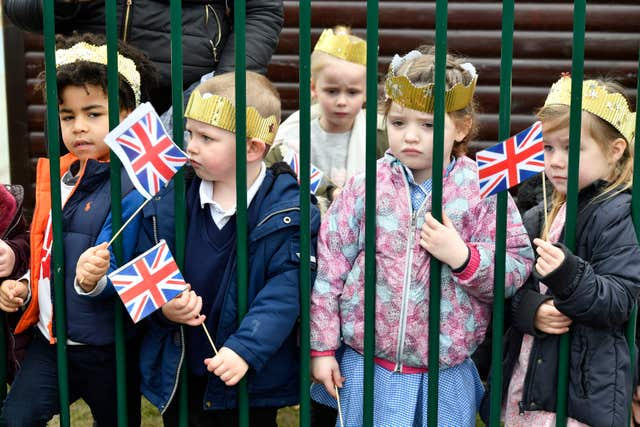 Schoolchildren wait for the Duchess of Cambridge to arrive (Arthur Edwards/Sun/PA)