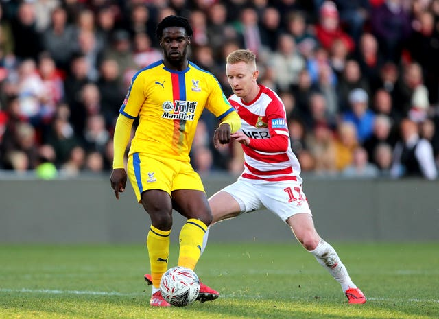 Doncaster Rovers v Crystal Palace – FA Jeffrey Schlupp (left) scored one of Crystal Palace's goals in their 3-0 win at Doncaster (Richard Sellers/PA).