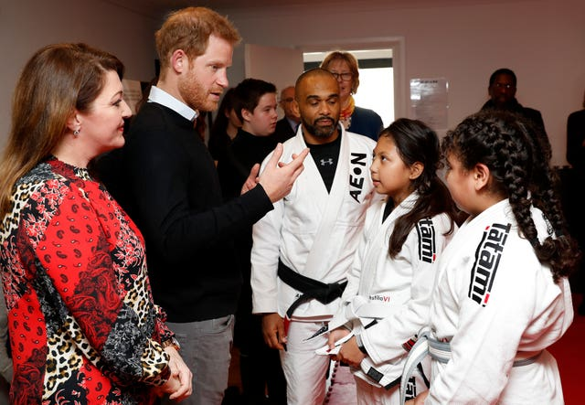 Harry meets participants in a jiu-jitsu session