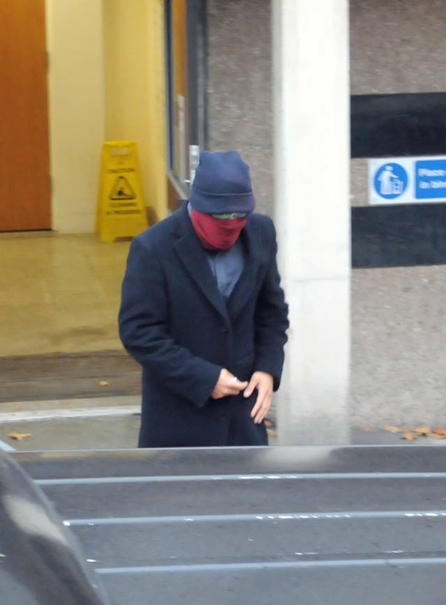 Jamien Nagadhana, 31, covered his face as he left Walsall Magistrates' Court, West Midlands (Matthew Cooper/PA)