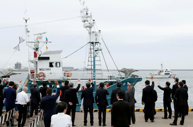 A whaling boat leaves a port in Kushiro, Hokkaido