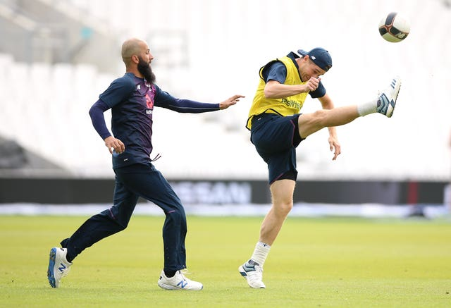England's Moeen Ali (left) and Chris Woakes during a training session