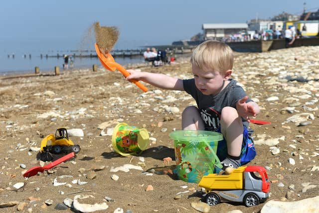 Kai, four, plays in the sand on Hunstanton beach in Norfolk as the warm weather continues (Joe Giddens/PA)