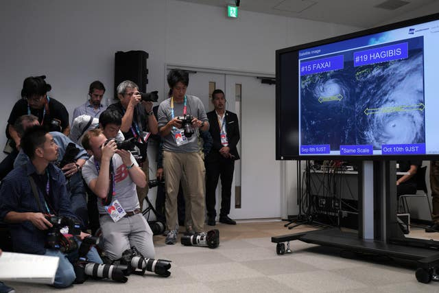 A satellite photo of Typhoon Hagibis is seen during a press briefing