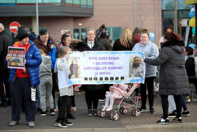 Protesters gather outside Alder Hey Children's Hospital (John Stillwell/PA)