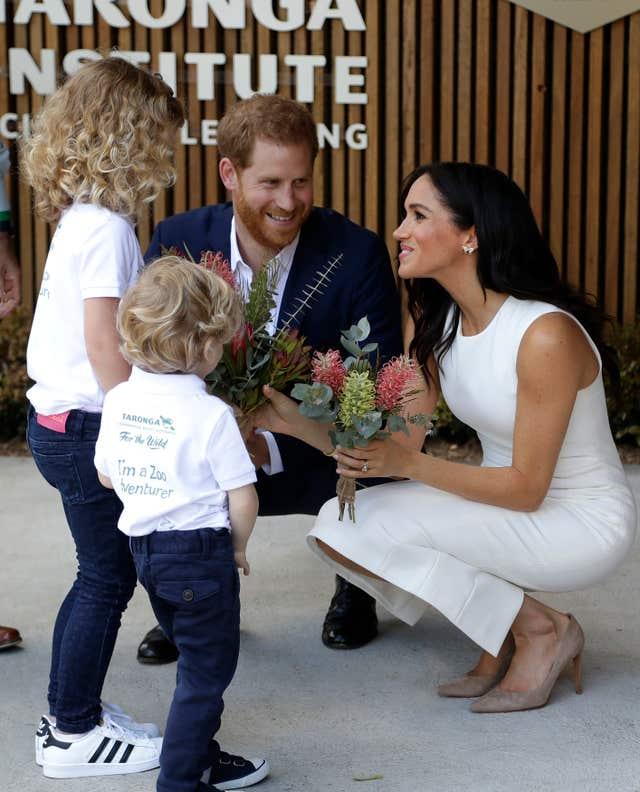 Harry and Meghan with children